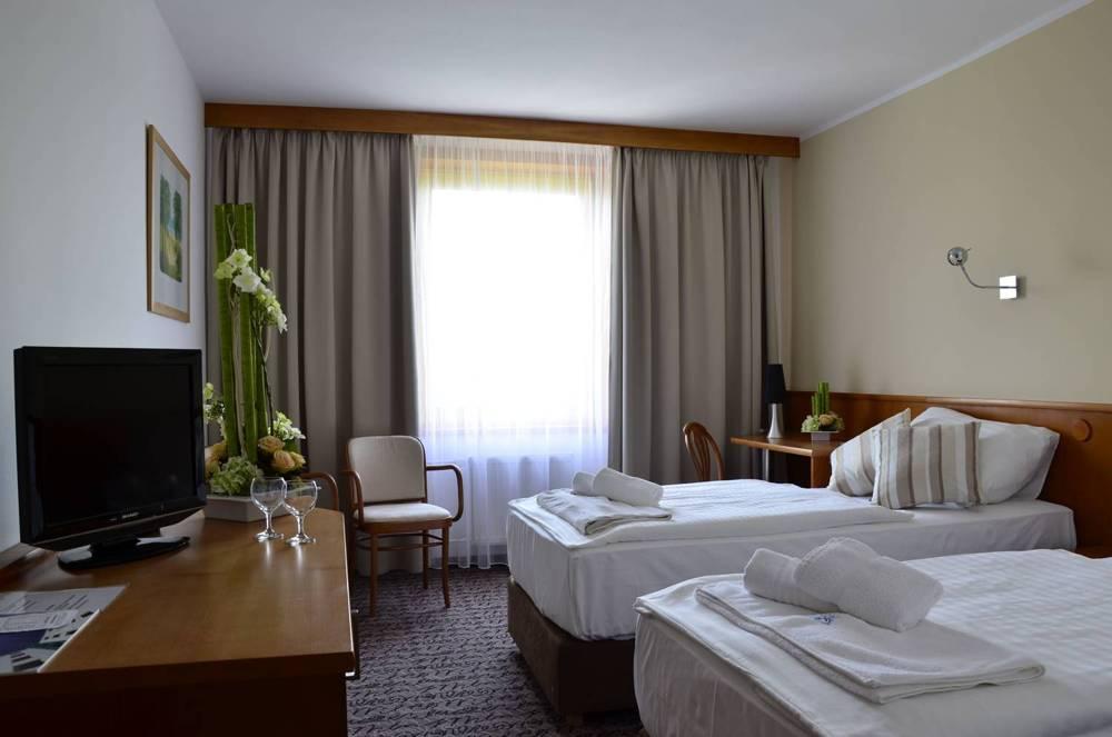 Pokoje{lang}Rooms